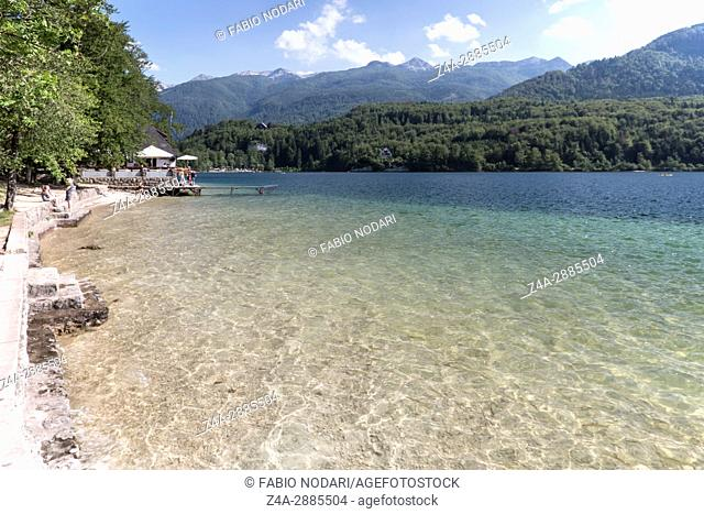 Tourist relaxing on lake Bohinj a famous destination not far from lake Bled, in Slovenia