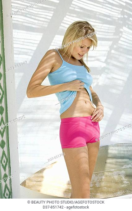 Young woman looking her tummy
