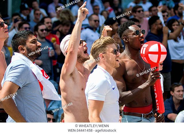 Football fans gather in Merchant Square in London's Paddington to watch England play Panama on a big screen at the FIFA World Cup 2018