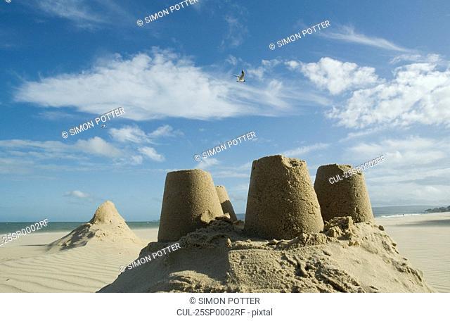 Sand castles under blue sky