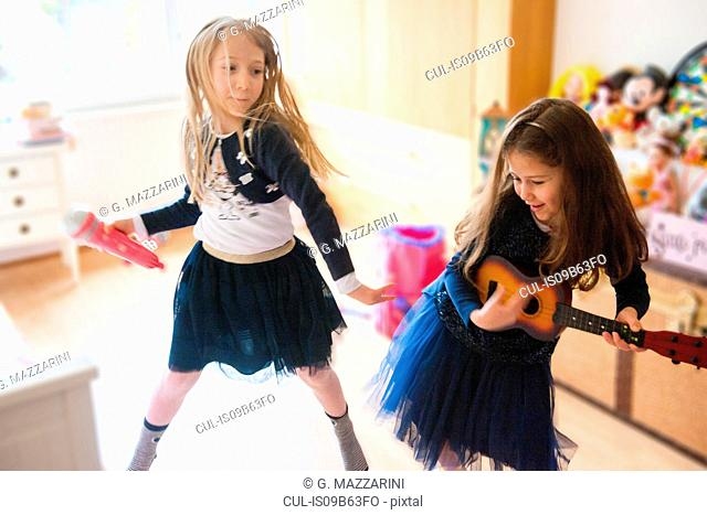 Girls singing, dancing, playing guitar