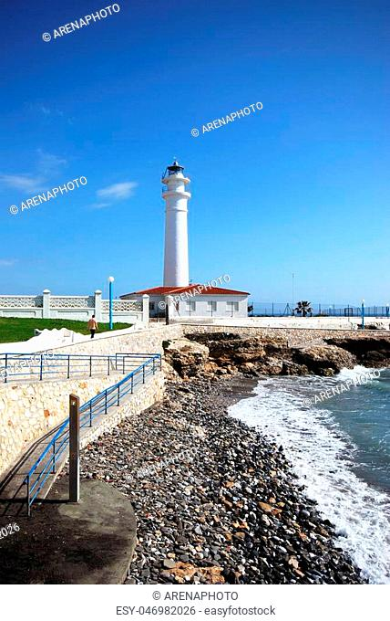 View of the whitewashed lighthouse along the rugged coastline, Torrox Costa, Malaga Province, Andalusia, Spain, Western Europe