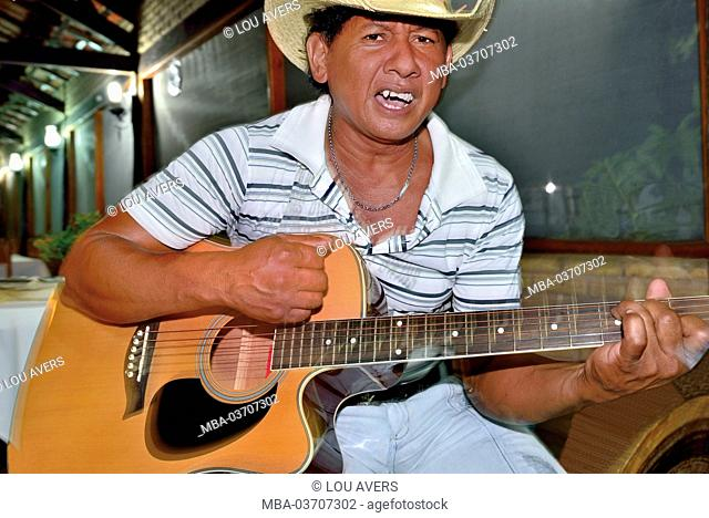 Brazil, Pantanal, local Pantaneiro plays the guitar