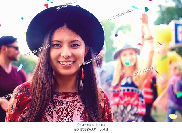 Portrait of young woman in trilby at festival