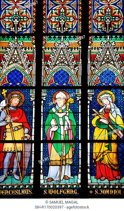 Stained Glass Window depicting from left to right St. Wenceslaus holding a cane and a shield, St Wolfgang holding a cane and a book
