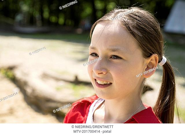 Close-up of a girl smiling in playground, Bavaria, Germany