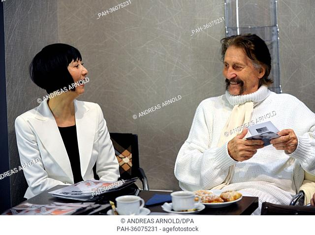 Designer Luigi Colani and his partner Ya-Zhen Zhao smile at trade fair for home and contract textiles 'Heimtextil' in Frankfurt Main, Germany, 09 January 2013