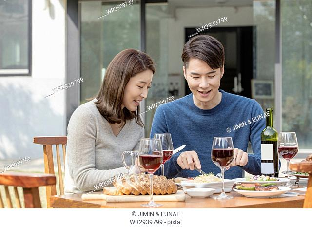 Portrait of young smiling couple at party in garden