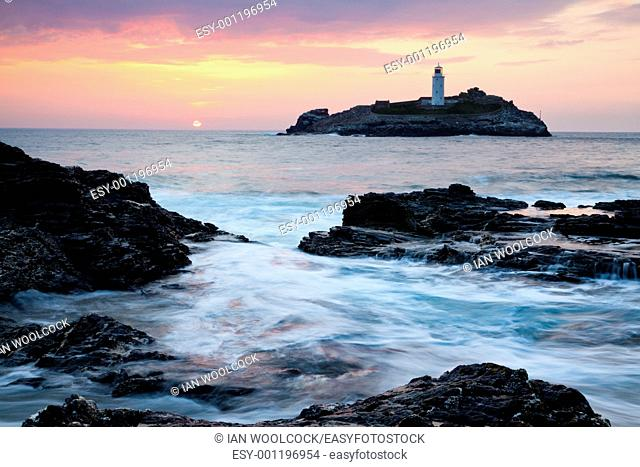 Sunset on the cliffs at Godrevy with Godrevy Island and Lighthouse in the background, England UK