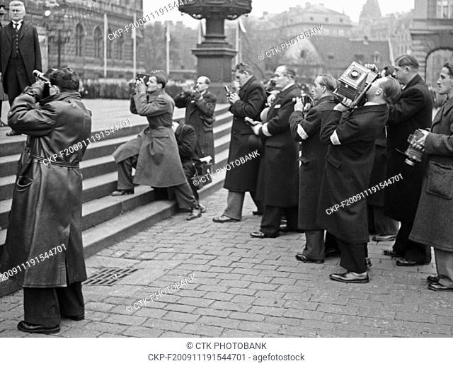 Journalists wait in front of the bulding of the Parliament (Rudolfinum) after the Presidential election in Prague, Czechoslovakia, November 30, 1938