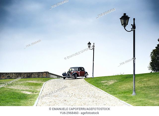 Newlyweds' vintage car at Castle of Govone, Piemonte, Italy