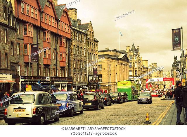 Cars and taxi cabs in the Old Town, Royal Mile, Edinburgh during Fringe Festival, Summer 2015, Scotland, United Kingdom