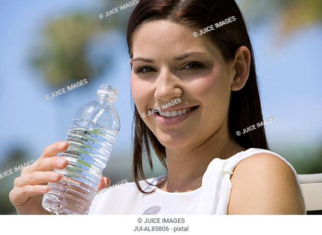 Woman holding water bottle