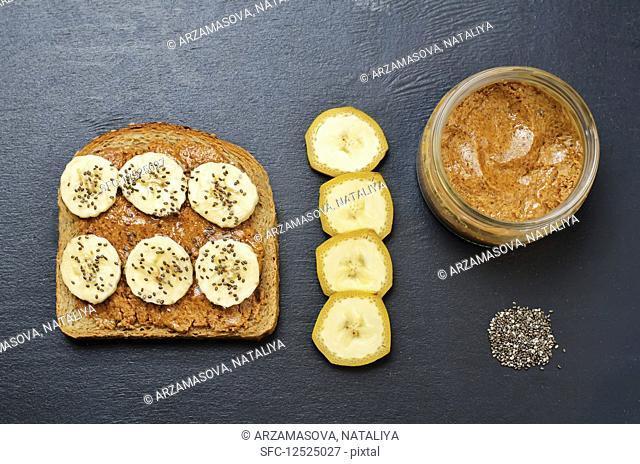 Healthy almond butter Chia seed banana rye breakfast sandwich