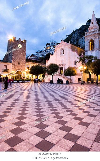 Evening in the Piazza IX Aprile, with the Torre dell Orologio and San Giuseppe church, Taormina, Sicily, Italy, Europe