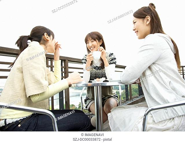 Women in the open-air cafe