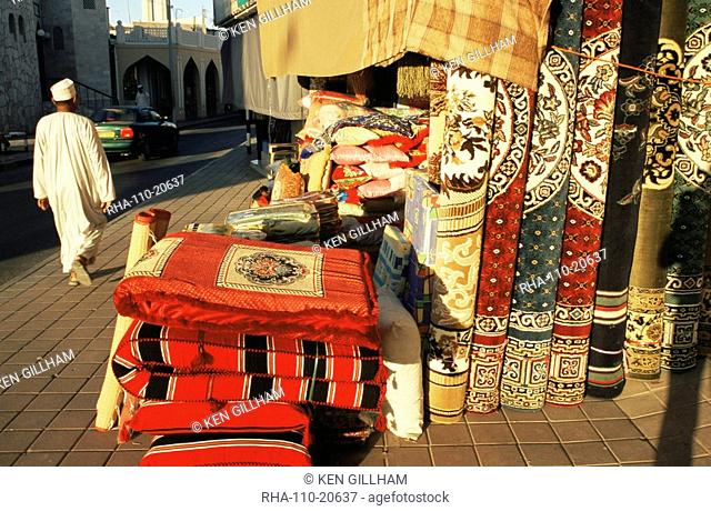 Carpets, cushions and rugs for sale near the Muttrah souk, Muttrah, Muscat, Oman, Middle East