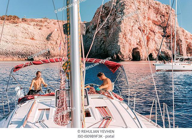 Friends on yacht, rock formation in background, Koralat, Zagrebacka, Croatia
