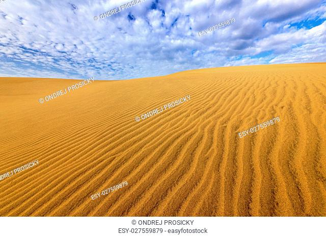 Sand desert with beautiful rare blue sky with white clouds