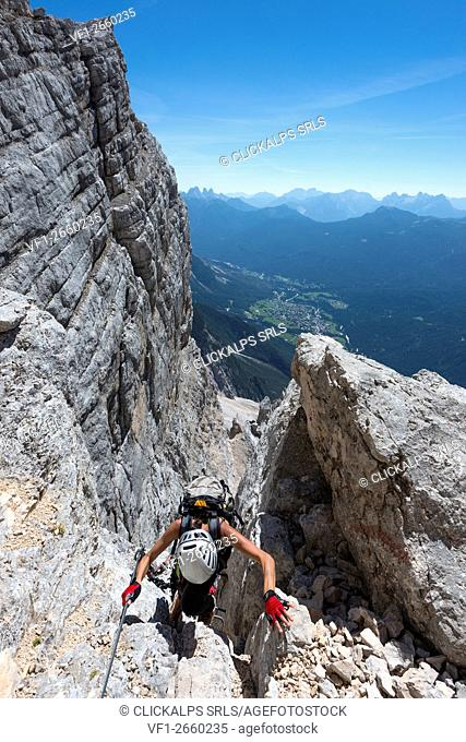Sorapiss, Dolomites, Veneto, Italy. Climber on the via ferrata Berti