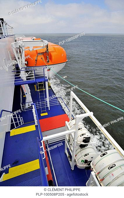 Inflatable liferafts in hard-shelled canisters and lifeboat on board of ferryboat, Europe