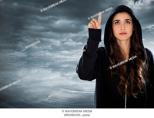 Woman hacker raising his finger in front of cloudy background