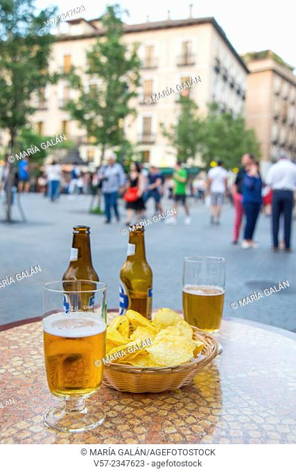 Two glasses of beer and chips in a terrace. Opera Square, Madrid, Spain