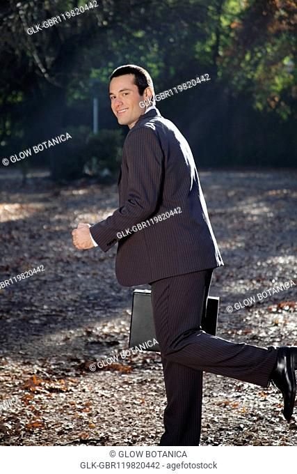 Businessman running in a park