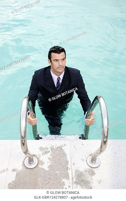 Businessman in a swimming pool