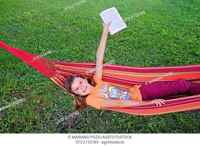 Young beautiful girl with book outdoor