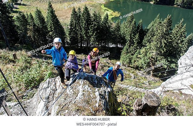 Austria, Salzburg State, Altenmarkt-Zauchensee, family at via ferrata