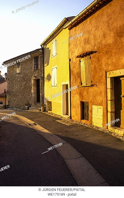 street and colourful houses of the Provence beamed by morning light, village Sainte-Croix-du-Verdon, department Alpes-de-Haute-Provence