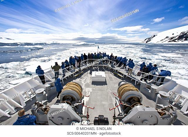 The Lindblad Expedition Ship National Geographic Explorer pushing through pack and sea ice in Antarctica in the summer months