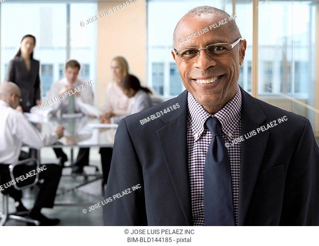 Black businessman smiling in office