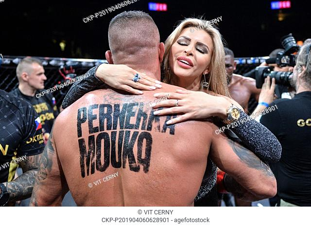 Czech MMA fighter Karlos Vemola hugs his girlfriend Lela Ceterova after win over French fighter Prince Aounallah, during the Night of Warriors gala evening on...