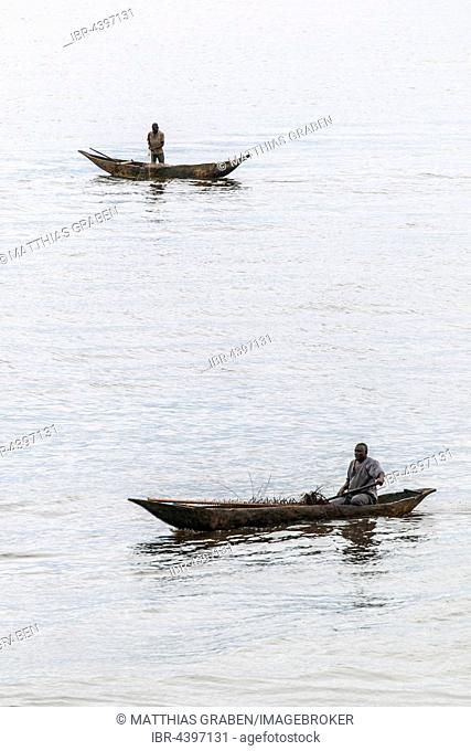 Two fishermen in a pirogue, logboat, Kribi, Southern Region, Cameroon