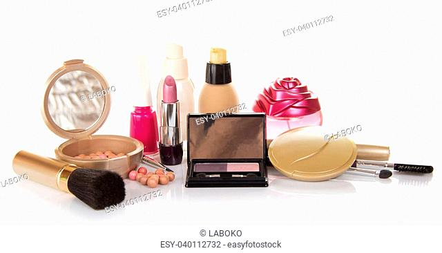 The set of decorative cosmetics, bottle of perfume and nail varnish, isolated on white