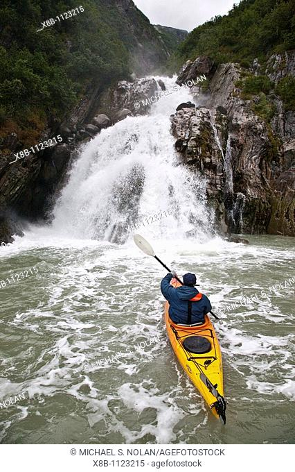 Staff from the Lindblad Expeditions ship National Geographic Sea Bird kayaking in Southeast Alaska, USA
