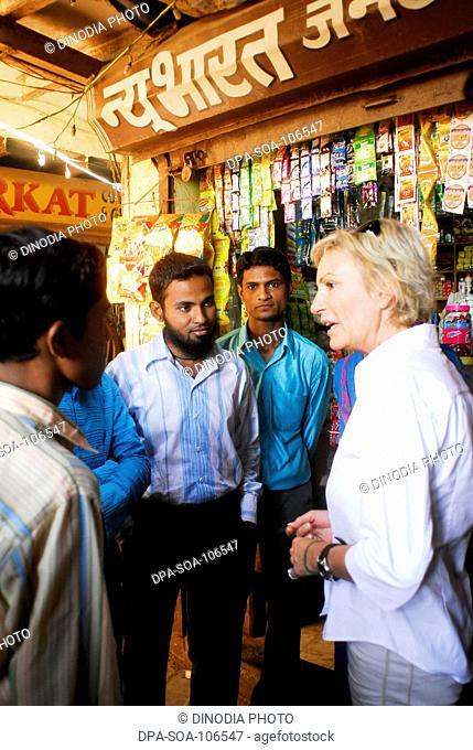 Sabine Christiansen in conversation with youth at Amrae an NGO at Nehru Nagar ; Golibar Slum ;Santacruz ;Bombay Mumbai ; Maharashtra ; India NO MR
