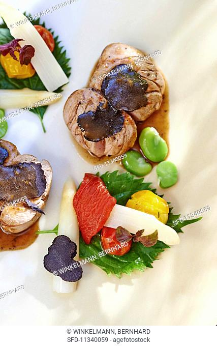 Veal fillet migon with truffle and vegetables (seen from above)