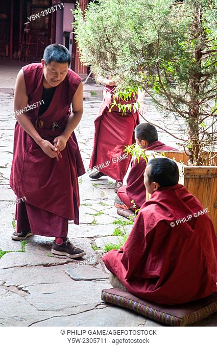 Buddhist monks engage in ritual debate at the Jokhang Temple in Lhasa, Tibet