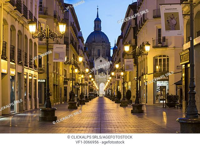 Calle Alfonso and the Cathedral of Our Lady of the Pillar at dusk. Zaragoza, Aragon, Spain, Europe