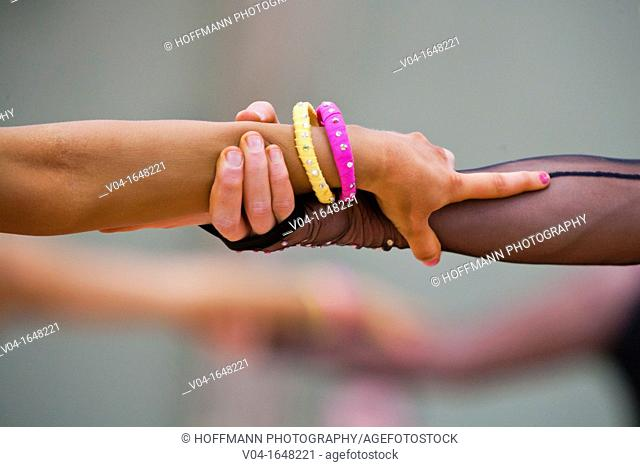Couple holding hands at a dancing competition in Germany, Europe