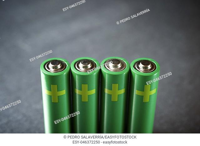 Four batteries on a metal table