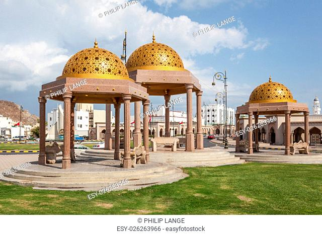 Pavilions with golden cupolas in the old town of Muttrah. Muscat, Oman, Middle East