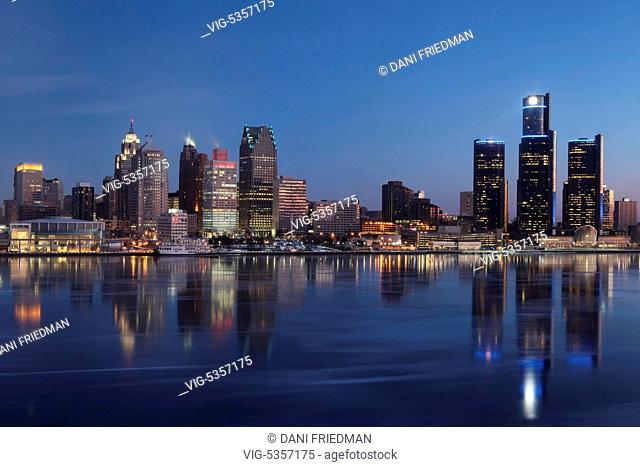 The skyline of Detroit, Michigan, USA and the Detroit River seen from the city of Windsor in Ontario, Canada at dawn. Detroit's population has sunk to 700