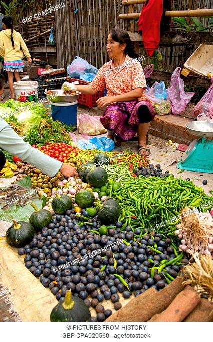 Laos: Fruit and vegetable vendor at the Morning market, Luang Prabang