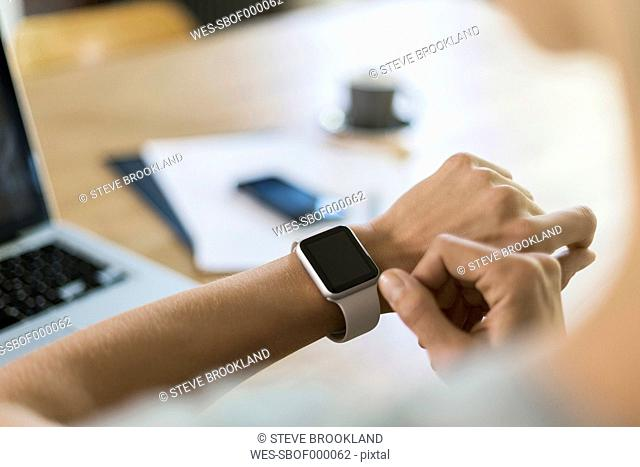 Woman looking at smartwatch