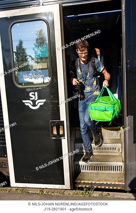 Man stepping off train Northern Sweden