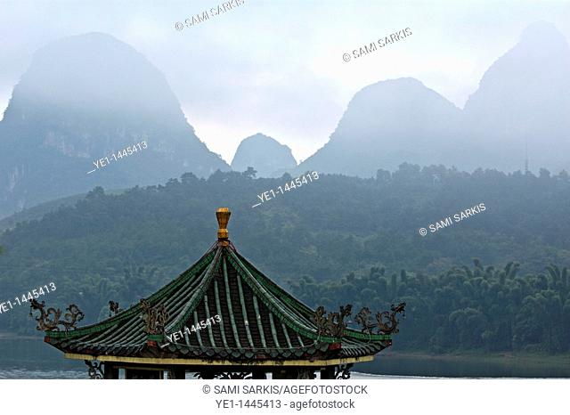 Typical Chinese pavilion on the banks of the River Li at sunrise, Yangshuo, Guangxi, China